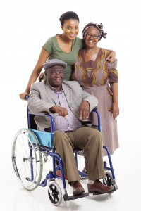 handicapped african man with wife and daughter